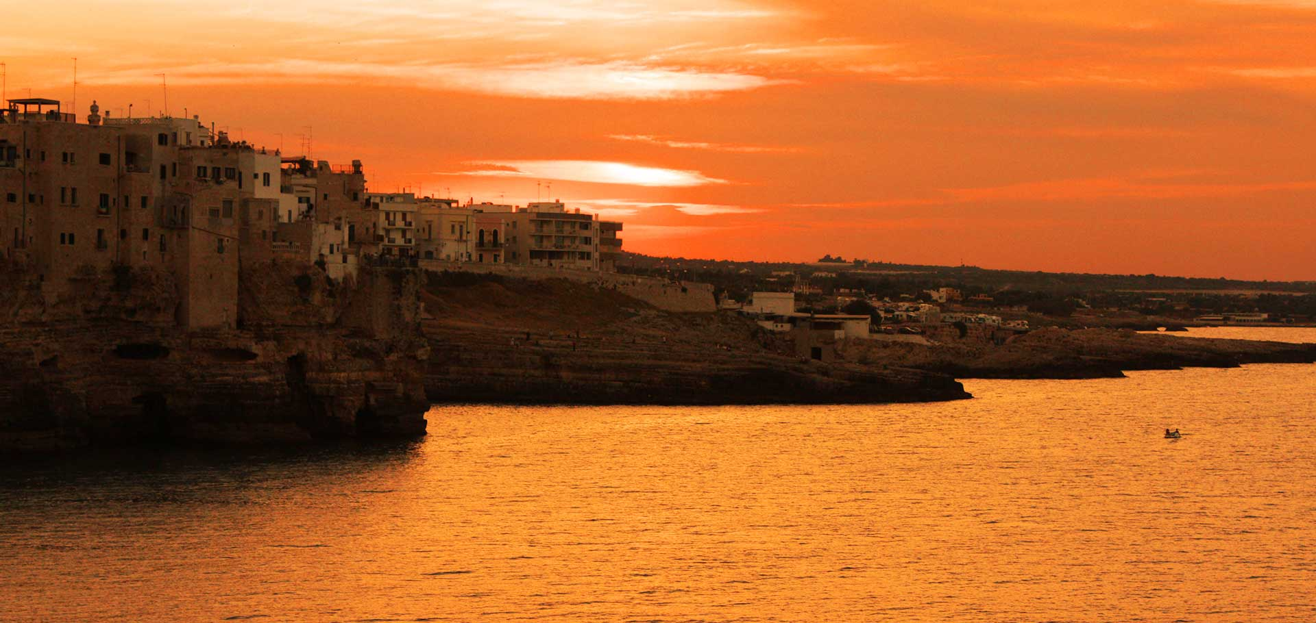 sunset over polignano a mare