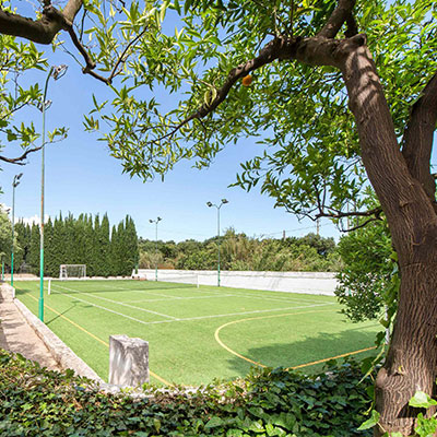 private soccer/tennis court in the garden